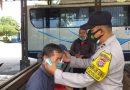 Tekan Penyebaran Covid-19, Polsek Bontang Barat Giatkan Patroli Dan Pembagian Masker